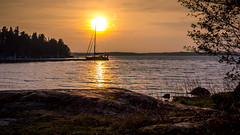 Seaside sunset (Jens Haggren) Tags: sun sunset sky colours water sea seascape rock boat landscape sweden