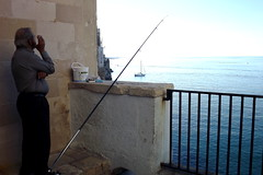'The old man and the sea' (bulgit) Tags: fisherman sea fish waiting smoking cigarettes hemingway infinity thinking life struggle aging boat stones merging sky polignanoamare italy