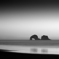 Silhouettes (panfot_O (Bernd Walz)) Tags: rock rocks twinrocks sea seascape water waterscape beach oregon pacific ocean coast shore longexposure blackandwhite bw monochrome fineart square minimal minimalism contemplation silence calm peaceful zen