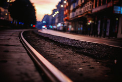 vibrate (ewitsoe) Tags: street 35mm buildings 50mm dawn lights track cityscape crossing dof close bokeh tracks tram poland transit essence narrow poznan sunrsie nikond80 lowfocus ewitsoe erikwitsoe
