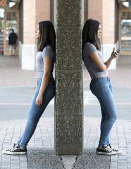 girl_AV_4384 (David Duane Photography) Tags: phone stripes butt young bored cellphone jeans celphone divider divide