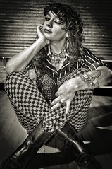 Daphne (P Shooter) Tags: blackandwhite tower girl tattoo nikon boots retro fresno spike paintshoppro checkers curlyhair spikes prettygirl topaz towerdistrict retrogirl fresnofamous fresnocalifornia tattoogirl nikond90 cityoffresno topazadjust towerdistrictfresno paintshopprox6