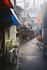 Showa -  (Shoji Kawabata. a.k.a. strange_ojisan) Tags: street camera japan analog cn 35mm way tokyo back lomo lca lomography alley backstreet alleyway land   100 filmcamera scape showa   fujicolor  analogcamera   35mmlca