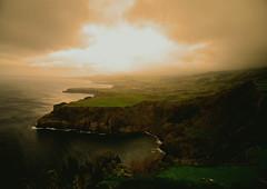 Fire the green (E-C-K ART) Tags: pontadelgada westcoast landscapescenery foggy sunset green hilly acores misty coastline