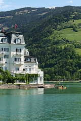 Zeller See (violinconcertono3) Tags: trees lake snow mountains alps tourism water beautiful clouds forest landscape austria boat relaxing bluesky accommodation zellamsee tranquil grandhotel pinzgau salzburgerland zellersee touristlocation