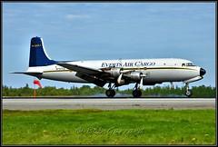 N747CE Everts Air Cargo (Bob Garrard) Tags: n747ce everts air cargo douglas c118a liftmaster dc6a anc panc tire smoke propliner