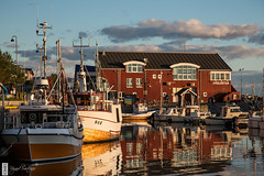 Bod (c3nes) Tags: city building norway reflections boats norge harbour latenight woodenboat fishingboat bod lowsun nordland