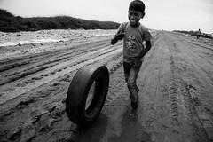 Rider.... (Karthikeyan.chinna) Tags: karthikeyan canon canon5d people mono happy happiness travel rameswaram dhanuskodi cwc chennaiweekendclickers tamilnadu india kid game play candid street streetlife life