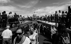 coming & going (stevenp74) Tags: bridge sky people woman white black men london monochrome st walking sony wide millenium pauls distance 28mmf2