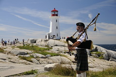_DSC6716 (c_marnell) Tags: novascotia peggyscove lighthouse bagpiper canada