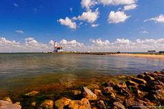 The lighthouse of Marken (Johan Konz) Tags: lighthouse island marken waterland netherlands water blue sky white clouds outdoor scenery nikon d90 sea shoreline waterfront landscape polfilter wandelrouterondmarkenoverdedijk paardvanmarken shore beach coast seaside horseofmarken