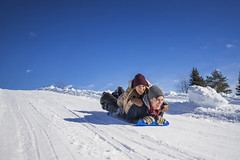 Two friends sliding downhill on crazy carpet (rsjogartref) Tags: activity adults canada canadian caucasian cold couple crazycarpet daylight downhill enjoyment friends friendship fun happiness jacket leisure lifestyle love man millenials montreal north northern ontop outwear people playful pleasure quebec scarf season seasonal sled sledding sliding snow weather white winter woman young