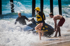 Oceanside Lifeguards (EthnoScape) Tags: oceanside california cityofoceanside firedepartment firedept lifeguard lifeguards oceansidelifeguard oceansidelifeguards oceansidepier lifestyle training drown drowning surf surfer surfers surfboard lifesaver lifesavers rescue rescuer rescuetube rookie swim swimming swimmer swimmers athlete athletic health fitness youth boardshorts bikini wetsuit neoprene danger riptide ripcurrent red yellow baywatch fins swimfins tower lifeguardtower beach shore ocean water safety tourist touristseason jetski summer sun sunset sunlight silhouette stock ethnoscape ethnoscapeimagery