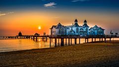 new day is awakening (K.H.Reichert) Tags: seebrcke sunrise sandstrand rgen strand steg pier himmel sky balticsea sonnenaufgang jetty sellin beach ostsee mecklenburgvorpommern deutschland de architectur meer sea seascape
