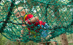Caught in the net (tortipede) Tags: sony a500 1870 zoom fromraw rawtherapee holiday france frana occitanie midi migjorn migjorn hrault herault erau fort bessilles acrobates climbing child boy brunoscottbuck parcours papeur geotagged geo:lat=4347561 geo:lon=354035 languedoc llenguadoc lengadoc occitnia