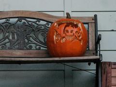 Triple Face Jack o' Lantern (prima seadiva) Tags: halloween jackolantern putto cherub bench orange autumn