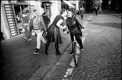 (Whisper) (Robbie McIntosh) Tags: leica girls blackandwhite bw woman film monochrome bike analog 35mm whisper message 28mm strangers streetphotography rangefinder bn negative ilfordhp5 400 hp5 mp analogue pushed ilford biancoenero argentique dyi selfdeveloped 800iso pellicola elmarit analogico leicamp leicam filmisnotdead ultrafin ultrafinplus autaut leicaelmarit28mmf28iii tetenalultrafinplus elmarit28mmf28iii