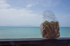 Where do you want to eat your banana chips? (bSlaney) Tags: ocean travel family blue vacation beach brad thailand island coast pier town paradise view sweet sony banana chips backpacking salty thai railing maenam slaney nex hiliday 5n arroy