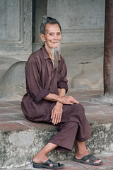 Vietnam - elderly man (Pietro Faccioli) Tags: old travel portrait people man male senior beard asian temple person hands asia exterior purple serious strangers monk oldman vietnam mature elderly abroad elder aged hanoi eastern pietro faccioli pietrofaccioli