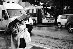(guilherme.ziggy) Tags: street bw woman rain canon outside mono blackwhite sopaulo monochromatic rainy consolao oriental t3i 600d