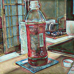 Still Life with Squished Computer and Tea Bottle 1 (sjrankin) Tags: 18july2016 edited processed filtered yubari hokkaido japan tea bottle teabottle door computer