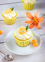 Cupcakes with cream cheese on white wooden table. (azimavu) Tags: table cupcake white cake cream berry muffin chocolate fresh sweet dessert background bakery food closeup delicious gourmet baked snack tasty fruit yummy decorated mini cup texture nobody backery berries birthday celebration home unhealthy swirl homemade cozy still life orange cumquat rosemary flower decoration jar glass saucer silver