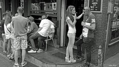 Amsterdam Street Scene with Smoking Girl (Eddy Allart) Tags: light red holland dutch bar cafe district fumar