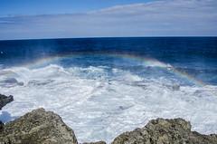 The Blowhole on Tongatafu, Tonga (firstfire53) Tags: southpacific tonga kingdomoftonga ocean waves breakers blowhole rainbow