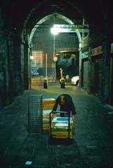 Genova (Etumies) Tags: streetphotography filmphotography analogousphotography leica leicaphotography italia italy genova genoa liguria ligure work worker shopkeeper crates night citynight