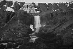 an Icelandic highway for water (lunaryuna) Tags: iceland westiceland westfjords landscape mountainrange rockface waterfalls dynjandiwaterfall textures spring season seasonalchange blackwhite bw monochrome lunaryuna