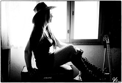 Lady 00.01 (ViTaRu) Tags: canon 5d lady woman sexy curves hat stockings fishnet boots gloves hair brunette guitar crate loudspeaker window light blackandwhite bw monochrome silhouette