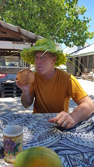 Tourist Fred enjoying fresh coconut milk.  Sam kindly made hats for each of us.