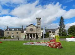 Grant Park, Forres, Morayshire, August 2016 (allanmaciver) Tags: grant park forres morayshire scotland blue sky clouds red peacock topiary trees st john evengelist church local central display banner allanmaciver