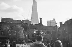 Untitled (alicepheebs) Tags: city people blur streets london film 35mm buildings blackwhite holga day central shard