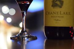 A Glass (littlekiss (Trying to catch up)) Tags: christmas light glass night restaurant wine bokeh wineglass
