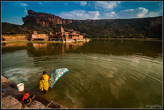 Life around Agastya Lake (ujjal dey) Tags: india lake reflection wash karnataka badami ujjal dailyactivity chalukyadynasty bhootnathtemple ujjaldey agastyalake ancientchlukyadynastyujjalujjaldeyancientbadamikarnatakaruinujjaldeyin