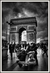 A Parisian Valantines Kiss (Missy Jussy) Tags: sky people bw paris france streets monochrome architecture clouds canon buildings bench lights mono blackwhite europe shadows streetphotography historical arcdetriomphe valentinesday canon1855 historicalcity cannon600d