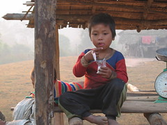 Akha child eating
