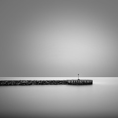 Solitude (thomas bach nielsen) Tags: ocean longexposure sea blackandwhite seascape denmark pier mole danmark bnw hav frederikshavn kattegat nordjylland nd110 nikond80 bwnd110 rnnerhavnen visitnordjylland