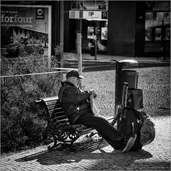 Time-out please... (John Riper) Tags: street bw white man black portugal monochrome smart canon john bench poster square photography mono zwartwit trolley lisboa lisbon candid luggage cap l trashcan baggage dustbin 6d forfour 24105 straatfotografie riper johnriper