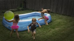 perpetual motion (Pejasar) Tags: backyard pool kiddie children grandchildren boys girls play run wet fun tulsa oklahoma