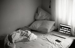 Bed (Trixi Skywalker) Tags: black white canon av1 kodak tmax400 trix 400 stockholm sweden sverige 50mm 18 window bed sheets camera analog analogue