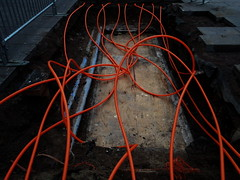 Orange cables (Eva the Weaver) Tags: orange curves ground cables works curled curve