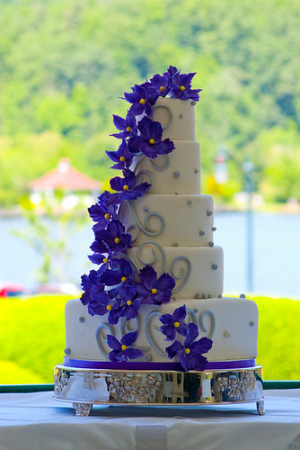 """A purple cascade of sugar flowers in this white and silver wedding cake. • <a style=""""font-size:0.8em;"""" href=""""http://www.flickr.com/photos/50891271@N03/15725772604/"""" target=""""_blank"""">View on Flickr</a>"""