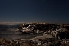 Frozen Rocks (Tuck Happiness) Tags: ocean longexposure winter sky moon ice night finland stars landscape frozen rocks nocturnal full clear 2015
