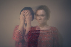 Ghost story (dawolf-) Tags: red portrait woman girl face canon eos hands dress curtain flash ghost rear spooky 5d sync courtain