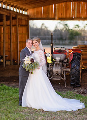 Bride and groom in front of barn - Wildberry Farms