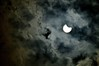 Solar Eclipse on a Cloudy Sky