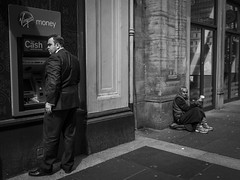 Economic Divide (Leanne Boulton) Tags: poverty life street city uk light shadow people urban blackandwhite bw white man money black detail male men texture monochrome face contrast canon mono scotland living blackwhite faces natural humanity outdoor expression glasgow candid homeless rich culture streetphotography documentary streetlife wideangle social scene beggar cash human shade 7d posture juxtaposition society atm economy depth tone facial begging vagrant cashpoint commentary wealth socialdocumentary urbanlandscape finance divide candidportrait ultrawideangle candidstreetphotography
