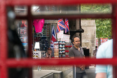 British (Stephen T Slater) Tags: london shop uk unionflag victoriaembankment missing pane redtelephonebox shopkeeper souvenir sunglasses england unitedkingdom gb